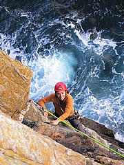 Angeles climbing on trad gear at Gogarth